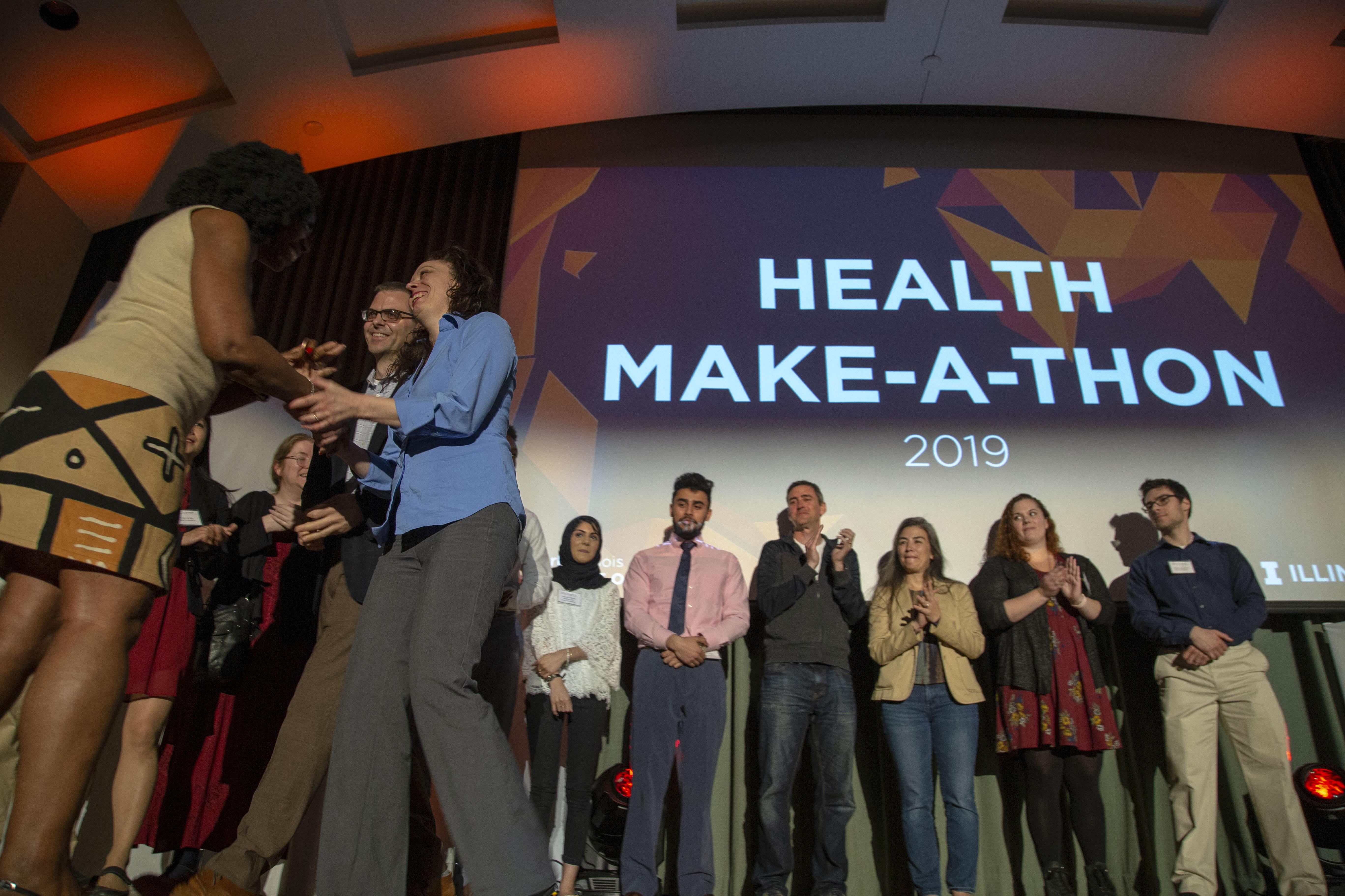 One Health Make-a-Thon winner, Sarah Nixon, receiving her Health Maker Lab coin.